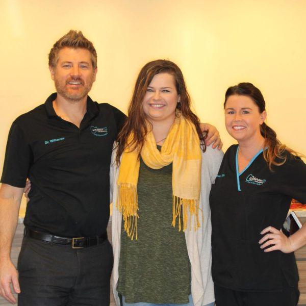 Happy patient with Dr. Witherow and staff member