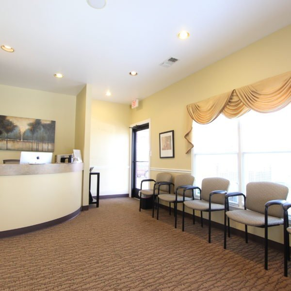 Open and bright waiting room with comfy chairs