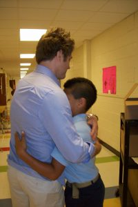 Dr. Witherow hugging a student